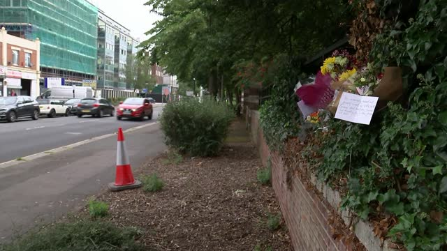 mehmood shamshi murder: 16-year-old boy arrested on suspicion of murder; england: london: hounslow: ext various shots of floral tributes on staines... - crime and murder stock videos & royalty-free footage