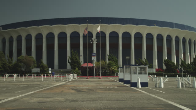 meidum angle of the forum staduim and parking lot. - inglewood video stock e b–roll