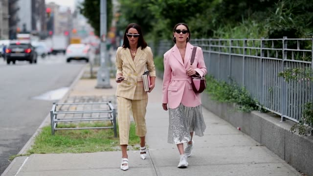 meital katz wearing beige suit with cropped pants and anna aronov wearing silver skirt and pink blazer seen outside oscar de la renta during new york... - street style stock videos & royalty-free footage
