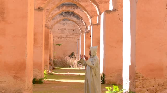 Meknes Morocco columns of Hri Souani former horse stalls in 17th century in downtown with sunlight
