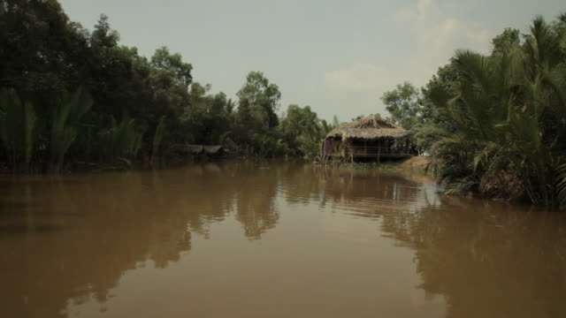 boat pov ws mekong river with stilt houses / vietnam - boat point of view stock videos & royalty-free footage