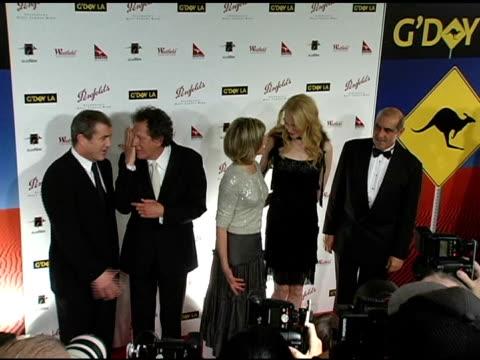 Mel Gibson Geoffrey Rush Olivia NewtonJohn Nicole Kidman and James Garner at the G'Day LA Penfolds Black Tie Gala Dinner at the Century Plaza Hotel...