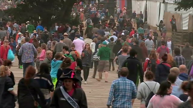 suffolk southwold ext crowds along at latitude festival 'comedy' area gv crowds along peter fincham interview sot mel was part of generation that... - latitude stock videos & royalty-free footage