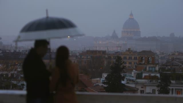 melancholic rome at sunset: rain in off peak season - umbrella stock videos and b-roll footage