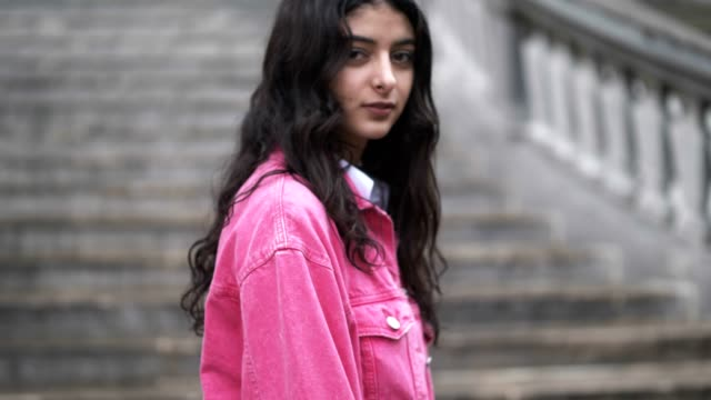 melanie darmon wears a bershka pink denim jacket an hm white dress shirt lise paris jewelry and gucci sneakers shoes on may 8 2017 in paris france - pink shirt stock videos and b-roll footage