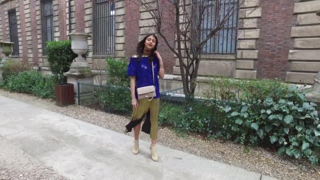 melanie darmon wears zara shoes zara dress chloe bag and hm studio top as she arrives at the nehara show street style paris fashion week day one... - chloe designer label stock videos and b-roll footage