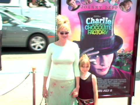 melanie griffith and daughter stella at the charlie the chocolate factory premiere at manns chinese theatre in hollywood ca - melanie griffith stock videos and b-roll footage