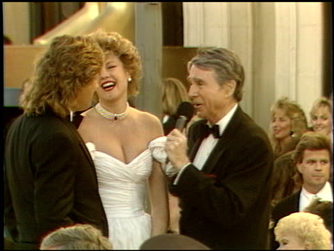 vídeos de stock e filmes b-roll de melanie griffith at the 1989 academy awards at the shrine auditorium in los angeles, california on march 29, 1989. - melanie griffith