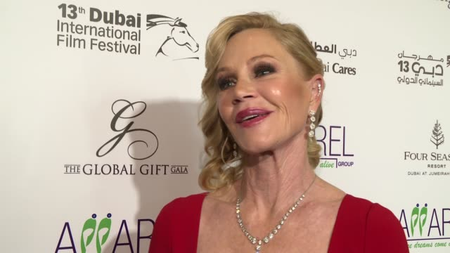 vídeos de stock, filmes e b-roll de interview melanie griffith on the ills of the world and what she's looking forward to this evening at 2016 dubai international film festival day 6 at... - melanie griffith