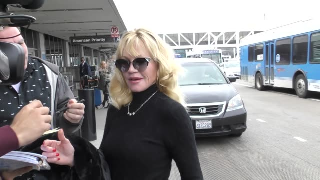 vídeos de stock, filmes e b-roll de interview melanie griffith talks about not seeing her daughter's movie 50 shades darker while departing at lax airport in los angeles in celebrity... - melanie griffith