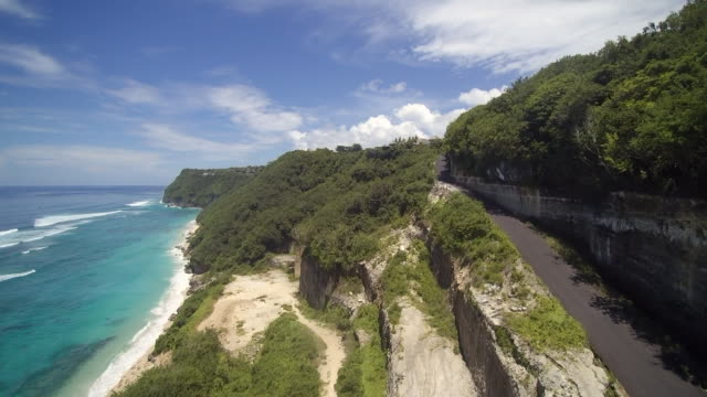 melasti beach bali indonesia - coastal road stock videos & royalty-free footage