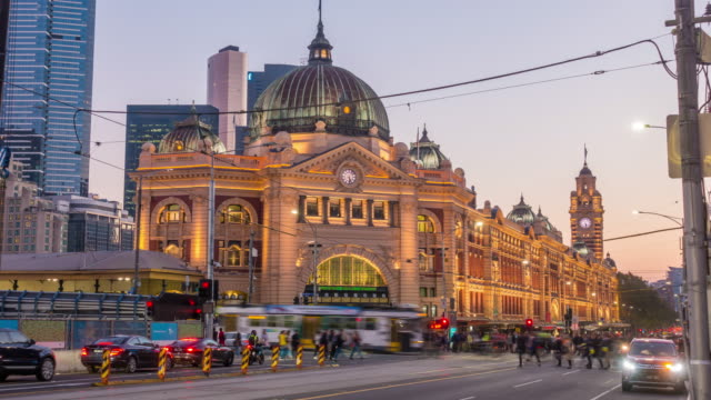 melbourne flinders street train station in australia at sunset - rail transportation stock videos & royalty-free footage