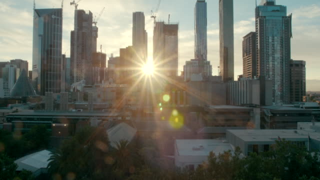 melbourne skyscrapers in the sunset (slow motion) - sunrise dawn stock videos & royalty-free footage