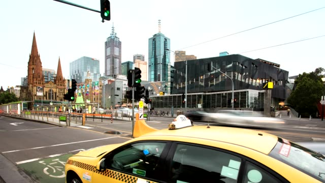 melbourne's downtown district time lapse, day to night view of the cathedral with traffic. - high street stock videos & royalty-free footage