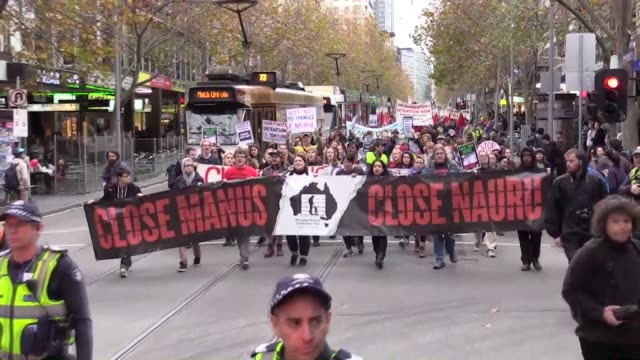 melburnians calling for the closure of detention centres on manus and nauru take part in a rally marking the world refugee week on june 18 2016 in... - 2001 stock videos & royalty-free footage