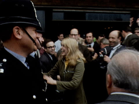 Melina Mercouri greets policemen and supporters in London during her campaign to restore democracy in Greece April 1968
