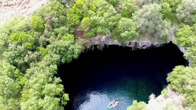 melissani cave - kefalonia - quadcopter stock videos & royalty-free footage