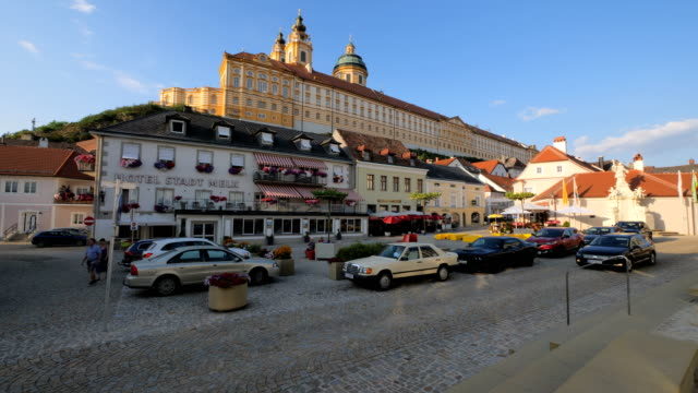 melk abbey as seen from town square afternoon - t shirt stock-videos und b-roll-filmmaterial