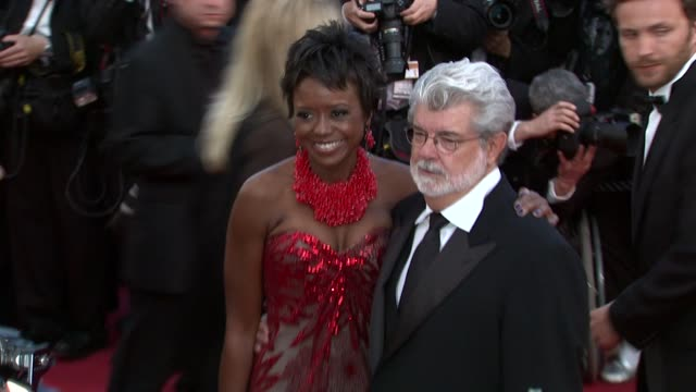 vídeos de stock, filmes e b-roll de mellody hobson and george lucas at the wall street money never sleeps red carpet cannes film festival 2010 at cannes - george lucas