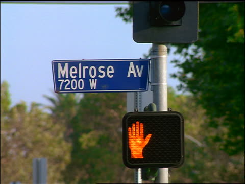 stockvideo's en b-roll-footage met melrose avenue sign above pedestrian signal light / los angeles - 1998