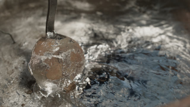 slo mo cu melted steel being stirred in large vat with ladle - handle stock videos & royalty-free footage