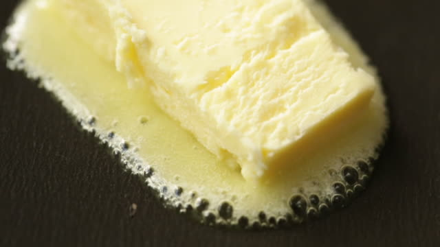 melting a piece of butter in pan - melting butter stock videos & royalty-free footage