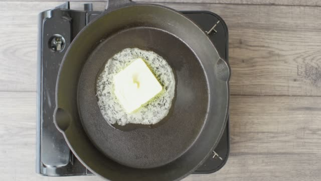 melting  butter in skillet pan for cooking - melting butter stock videos & royalty-free footage