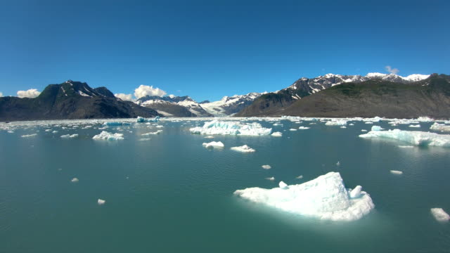 melting glacial ice symptom of environmental climate change - pacific war stock-videos und b-roll-filmmaterial