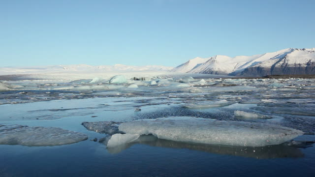 ws melting glacier floating and moving on jokulsarlon lake / iceland - icecap stock videos & royalty-free footage
