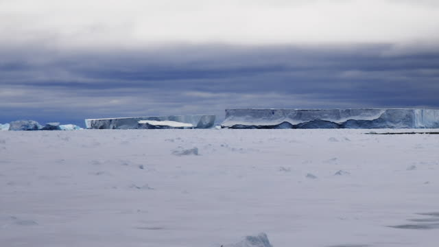 melting glacier in antarctica (time lapse) - antarctic ocean stock videos and b-roll footage