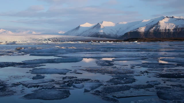 ws melting glaciers floating on jokulsarlon lake / iceland - icecap stock videos & royalty-free footage