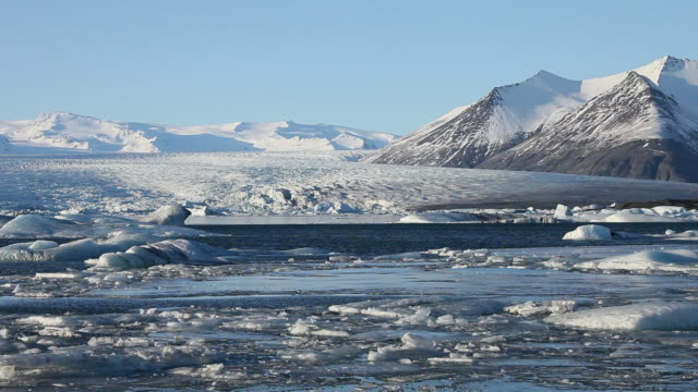 ws melting glaciers floating on jokulsarlon lake / iceland - icecap stock videos and b-roll footage