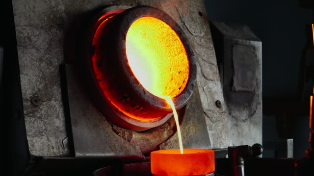 melting gold in the gold foundry - moulding a shape stock videos & royalty-free footage
