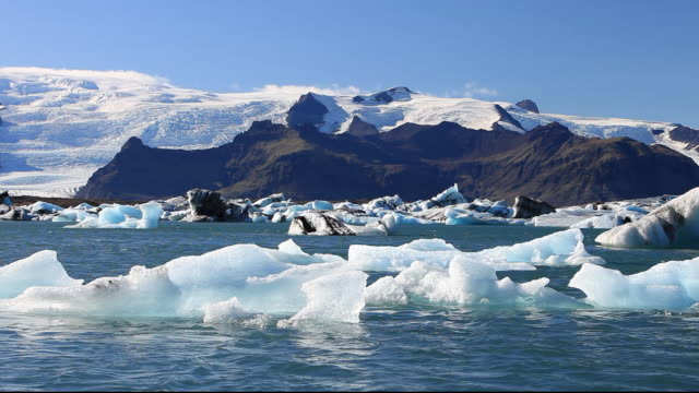 melting ice at the Jokulsarlon ice lagoon, one of the most visited places in Iceland. It has been created by the rapid retreat of the Breidamerkurjokull glacier which sweeps down off the Vatnajokull ice cap. Ice bergs calve off the front and float into the