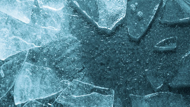 melting ice closeup texture. frozen ice full frame studio shot time lapse. - drinking water stock videos & royalty-free footage