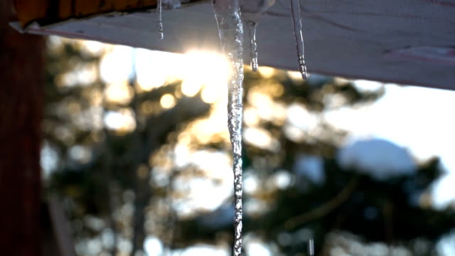melting icicles at sunset - roof stock videos & royalty-free footage