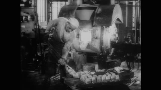 1940 melting metal for penny coins - money press stock videos and b-roll footage