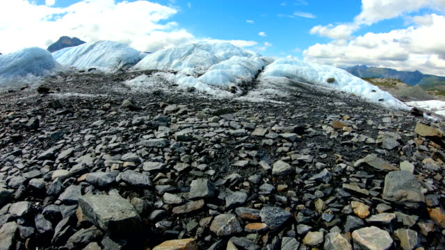 pov melting snow moraine debris summer heat alaska - rubble stock videos & royalty-free footage