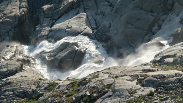 meltwater flows down a waterfall formed by the glacier's meltwater on august 23, 2019 near obergoms, switzerland. the glacier once covered both areas... - flowing water stock videos & royalty-free footage
