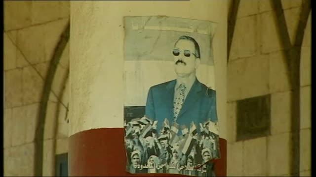 member of british embassy injured during terrorist attack tx various of posters and mural portraits of yemeni president ali abdullah saleh - president stock videos & royalty-free footage
