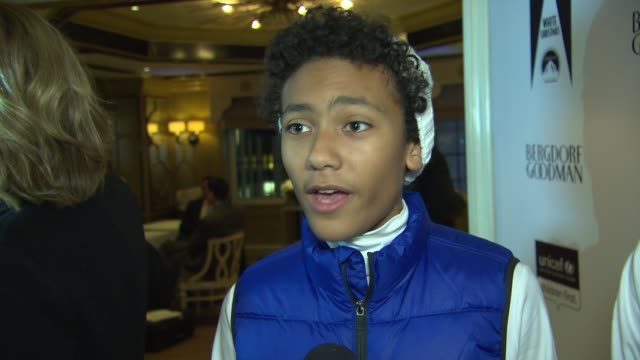 interview member of broadway kids care on what unicef does at 2014 bergdorf goodman holiday window unveiling unicef snowflake lighting at bergdorf... - bergdorf goodman stock videos and b-roll footage