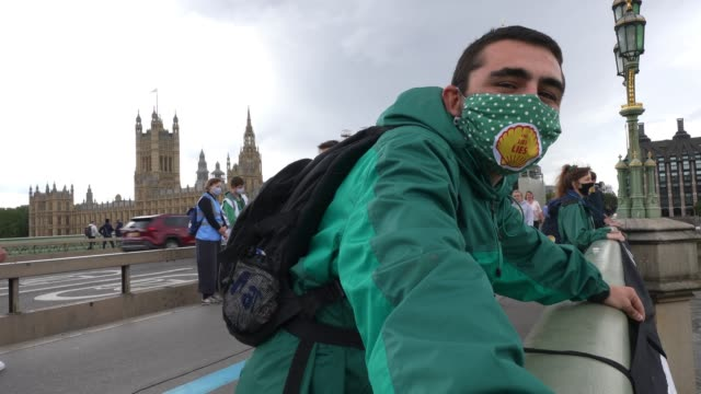 member of extinction rebellion holds part of a banner hung over westminster bridge protesting against multinational oil giant shell highlighting the... - focus concept stock videos & royalty-free footage