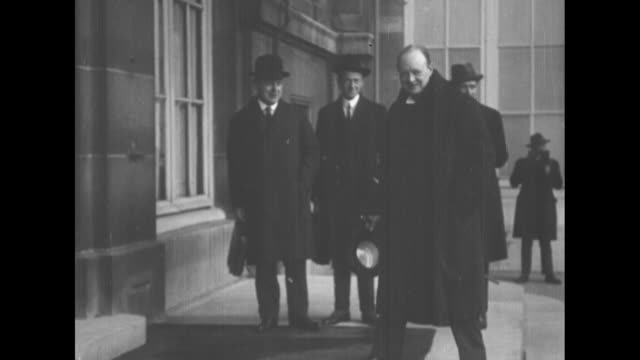 member of parliament winston churchill walks towards steps wearing heavy coat removes hat smiles stops and looks at camera / cu churchill talking to... - winston churchill stock videos & royalty-free footage