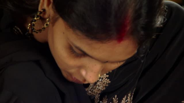 CU TD Member of Prerana women's group measuring and marking fabric, Lalkuan, Uttarakhand, India