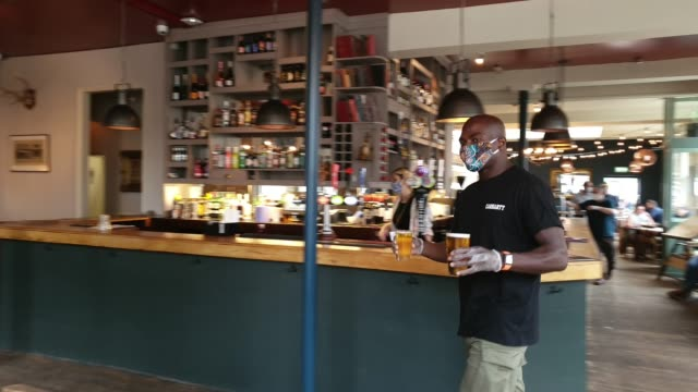 member of staff brings drinks to customers at the lordship pub, east dulwich on july 4, 2020 in london, england. the uk government announced that... - brian dayle coronavirus stock videos & royalty-free footage