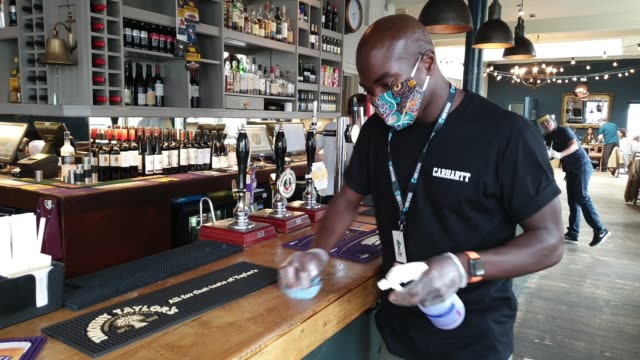 a member of staff cleans the bar and beer pumps at the lordship pub east dulwich on july 4 2020 in london england the uk government announced that... - パブ点の映像素材/bロール