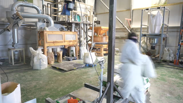 member of staff seals up bags of flour during operations at gilchesters organics mill, in stamfordham, northumberland, england, u.k, on monday,... - organic stock videos & royalty-free footage