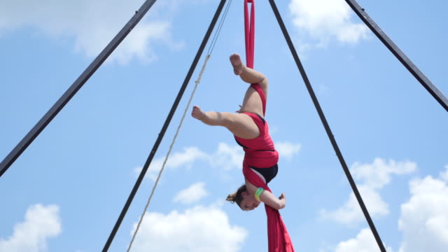 A member of the Aerialogy acrobat troupe demonstrates here skills on aerial silks during Spencer Pride Saturday June 3 2017 in Spencer Indiana The...
