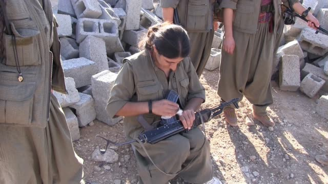 a member of the free women's units shortened as yja star the women's military wing of the kurdistan workers' party pkk cleaning a kalashnikov ak47... - kurdistan workers party stock videos & royalty-free footage