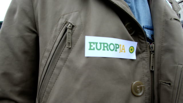 a member of the green party wears a sticker on his jacket with the inscription europe yes ska keller and sven giegold lead candidates for the german... - sticker stock videos and b-roll footage